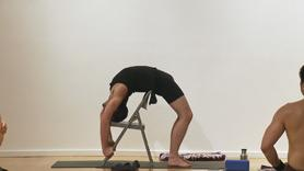 Backbends to create strength, stamina and playfulness. This strong class begins with sun salutations, standing poses in vinyasa, thigh stretches, forearm balance variations, backbends with props (block, strap, folding chairs), into upward bow 1 and 2 (urdhva dhanurasana I & II) and two leg inverted staff pose (dwi pada viparita dandasana) with a strap. This class uses a lot of props, to build opening with support, and the propped backbends can also substitute for the full poses. This class does not include savasana (final resting pose), so take extra time if you can to rest.